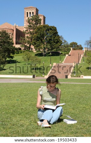 Young female student is reading for her class - stock photo