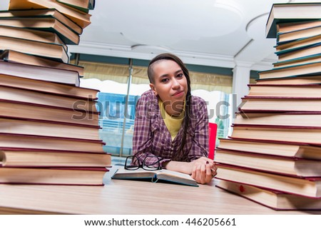Young female student preparing for exams - stock photo