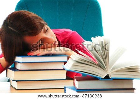 Young female student with many study books