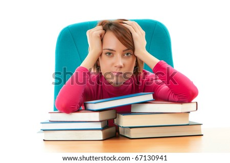Young female student with many study books - stock photo