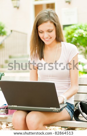 young female student with study materials - stock photo