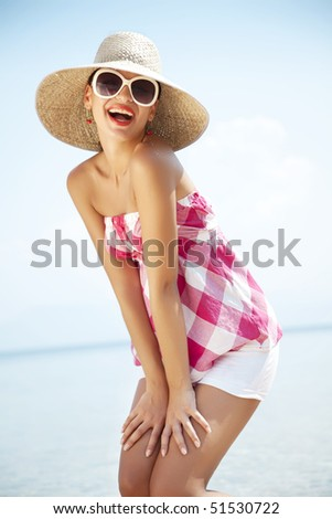 young female styled in vintage laughing to the camera - stock photo