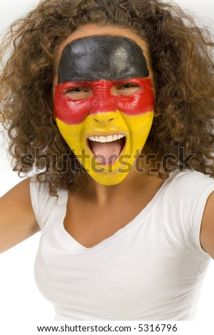 Young female supporter with painted German flag on face. Front view. She's looking at camera. - stock photo
