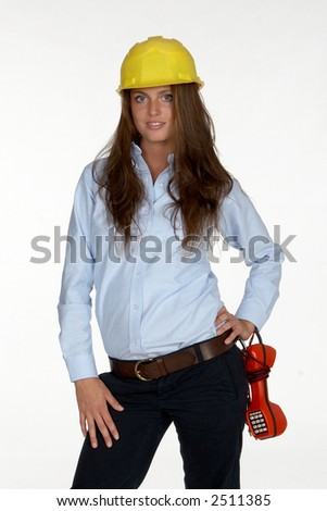 Young Female Telephone Technician with Hardhat and Butt Set - stock photo