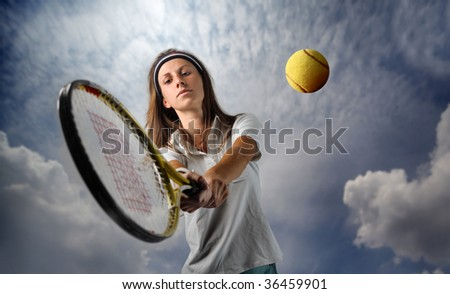 young female tennis player - stock photo