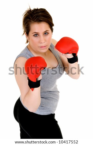 Young female thai boxer, studio shot, intense expression on face
