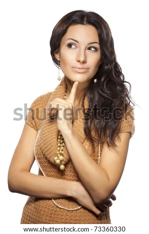 Young female thinking and pondering over something with her finger on the chin looking aside,  isolated on white background - stock photo