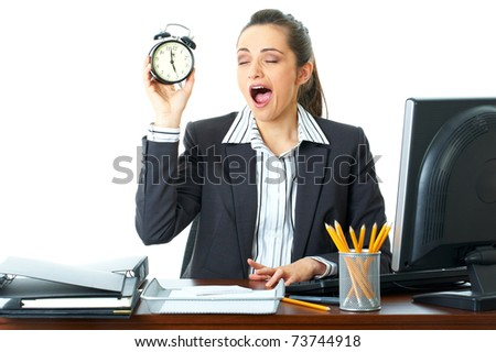 young female tired sleepy office worker holds clock in her hand, isolated on white - stock photo