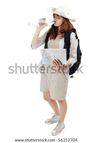 young female tourist drinking water and keeping map - stock photo
