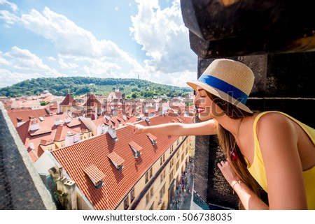 Young female tourist enjoying great view on the old town of Prague