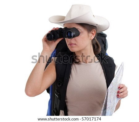 young female tourist in hat with backpack using binoculars