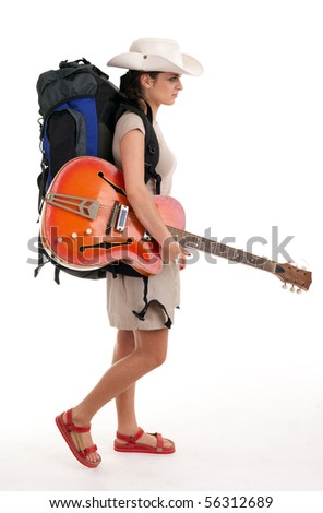 young female tourist with backpack and electric guitar