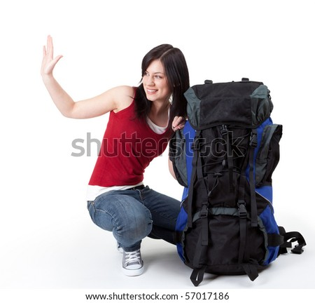 young female tourist with backpack, raised hand