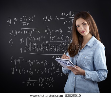 young female university student against blackboard