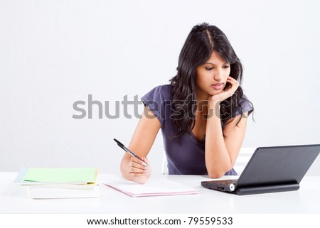 young female university student studying in classroom - stock photo