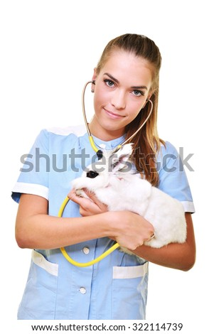 young female veterinarian doctor carrying a rabbit - stock photo