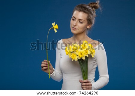 Young female with bunch of flowers on blue background, special flower - stock photo