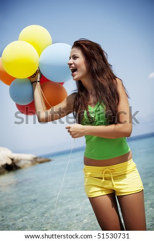 young female with colorful balloons - stock photo