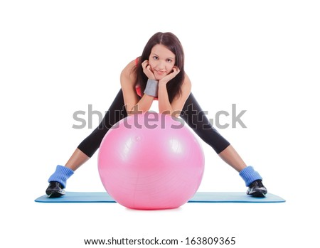 Young female with fitball over white - stock photo