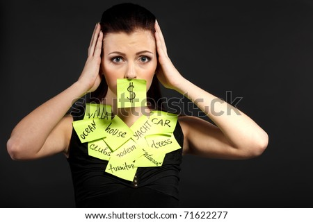 Young female with thoughts about money holding head - stock photo