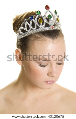 Young female with tiara isolated over white - stock photo
