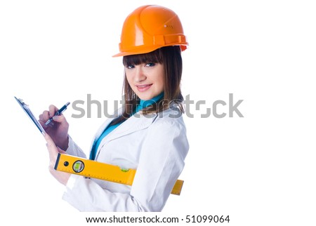 Young female worker with protection helmet and level at isolated background - stock photo