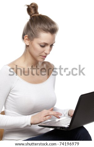 Young female working on laptop isolated on white background - stock photo