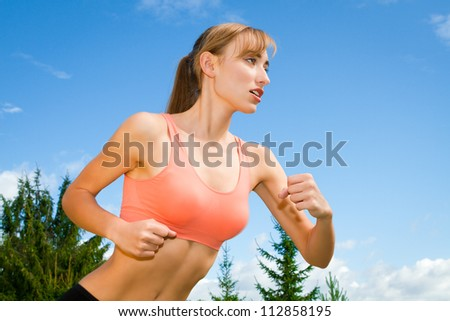 young females playing sports, jogging outdoors, recreation - stock photo