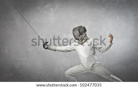 Young fencer on guard - stock photo