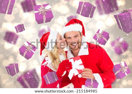 Young festive couple against light glowing dots design pattern