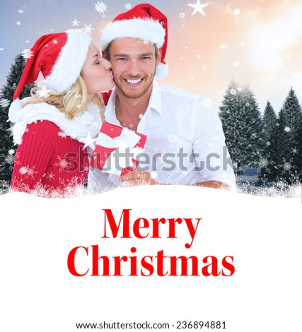 young festive couple against merry christmas - stock photo