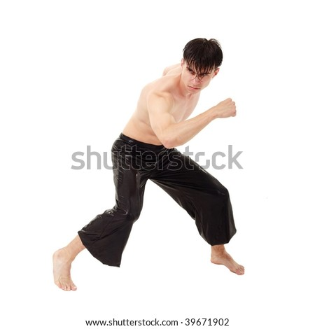 young fighter exercising against isolated white background - stock photo