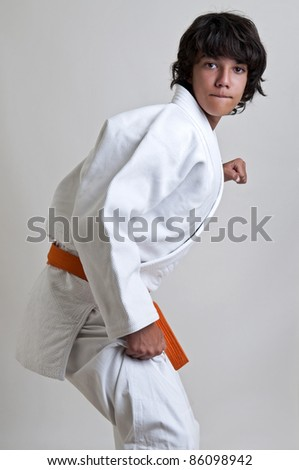 Young fighter posing isolated against a light background