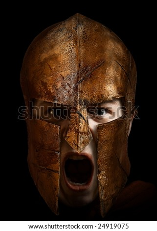 Young fighter shouting with a spartan helmet - stock photo