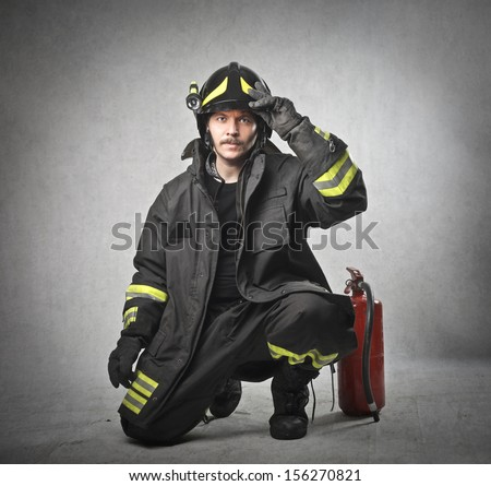 young firefighter with the equipment - stock photo