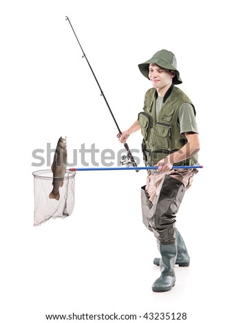 Young fisherman putting a fish into a fishing net isolated on white background