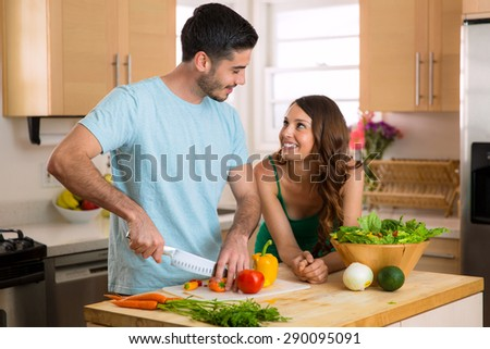 Young fit lovers making health food for lunch and dinner to keep in shape - stock photo