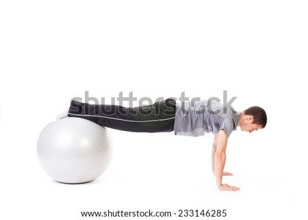 Young fit man doing plank on arms - isolated on white.