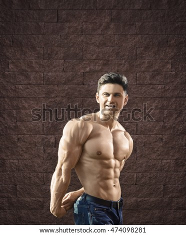 Young fit man is smiling and showing muscles -- toned and stylized photo