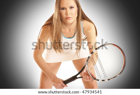 Young fit tennis player over grey background - stock photo