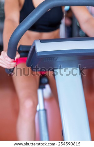 young fit woman doing sport spinning in the gym - stock photo
