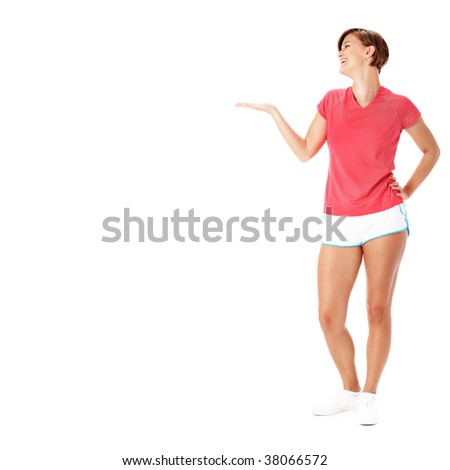 Young fit woman isolated on white presenting to empty copyspace, from a complete series of photos.
