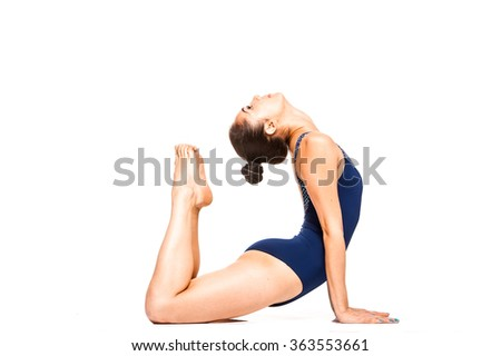 Young fit woman practicing yoga, stretching in cobra position, isolated on white - stock photo