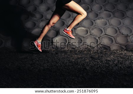 Young fit woman running fast. Close-up - stock photo