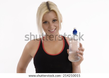 Young fit woman with drink bottle - stock photo