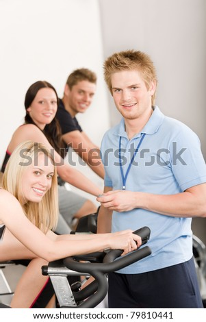Young fitness instructor at gym - stock photo
