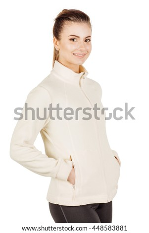 young fitness instructor wearing sportswear with hands in pocket, looking at camera.   . isolated on white background. fitness, sport and health concept.