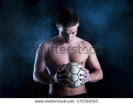 Young fitness model is posing in studio - stock photo