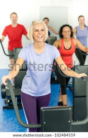 Young fitness woman at treadmill running class at the gym