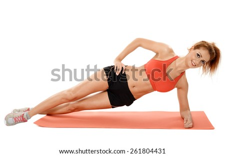 Young fitness woman doing exercises on a mat isolated on white - stock photo